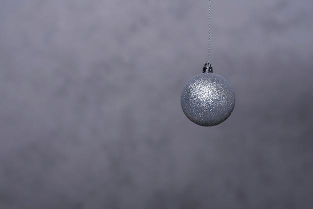 Silver christmas ball on thread