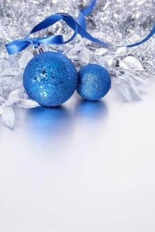 Silver christmas decoration with blue baubles
