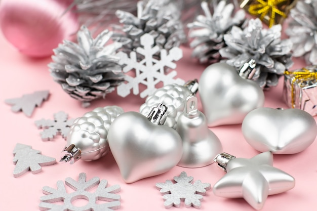 Silver christmas ornaments close up on a pastel background