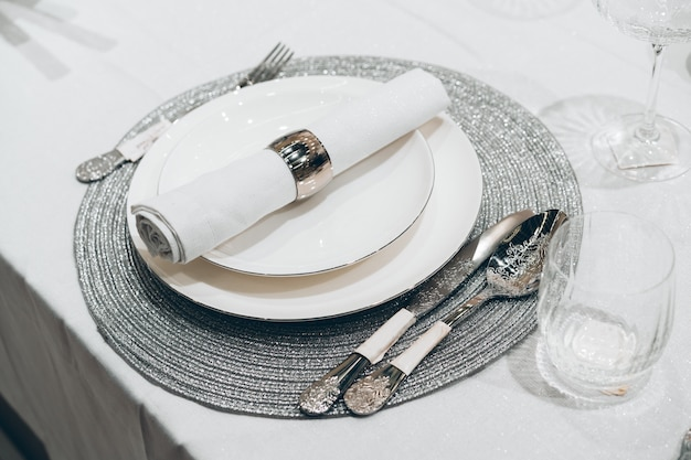 Silver christmas table setting on white table
