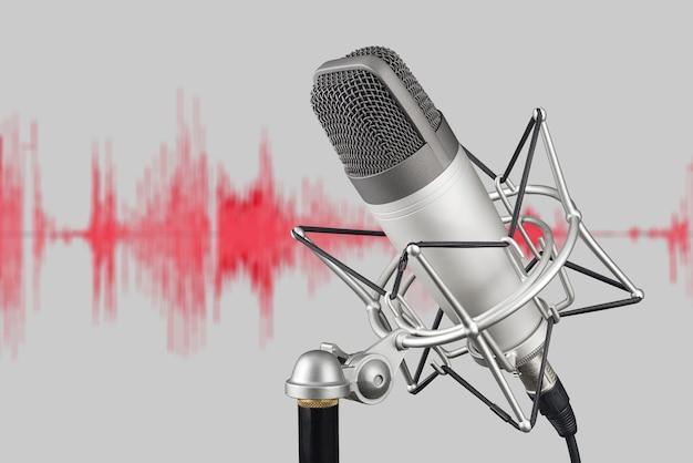 波形の背景に銀色のコンデンサーマイク。録音コンセプト