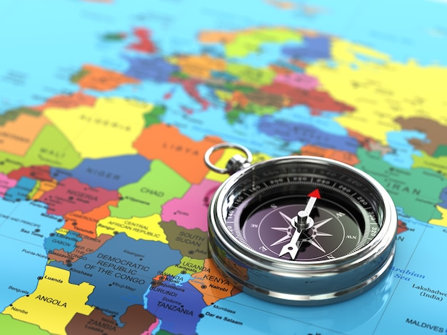 세계 지도 배경에 은색 나침반입니다. 3d