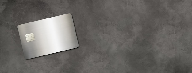 Silver credit card template on a black table . 3d illustration
