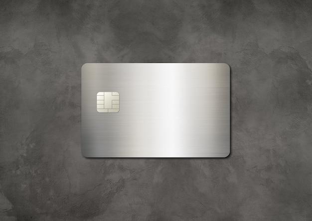 コンクリートの上の銀のクレジットカードテンプレート。