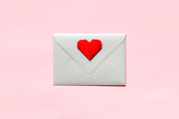 Silver envelope closed and origami heart