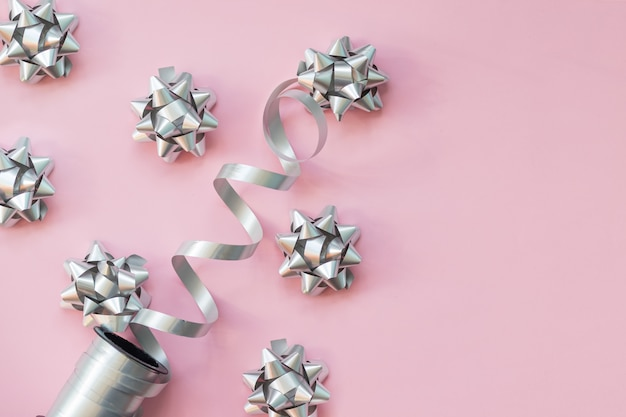 Silver gift bow isolated on pink background.set of decorative bows. card for holiday, valentine celebration, birthday