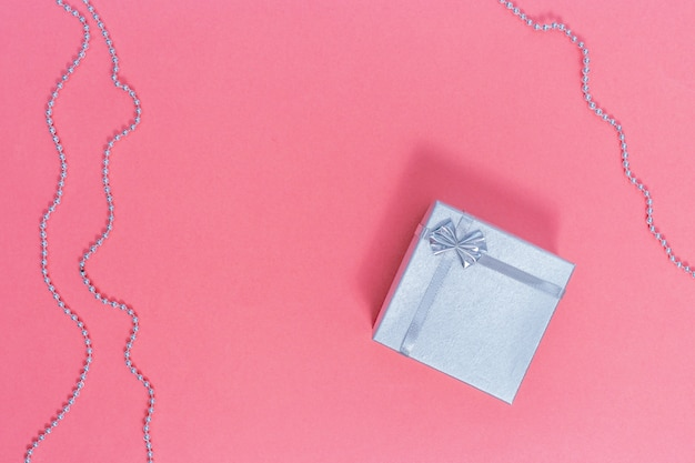 Silver gift box. valentine day composition on paper pink
