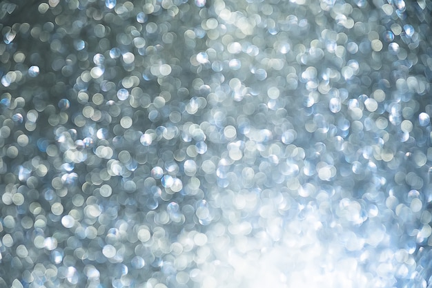 Silver glitter vintage lights background. blurred christmas abstract texture. defocused.