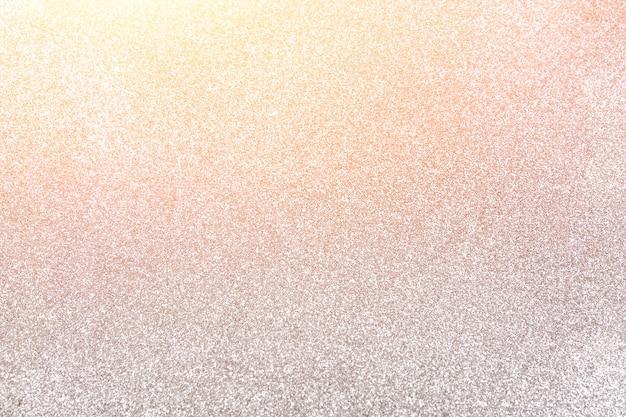 シルバーのきらびやかな背景、太陽の光とクリスマスの背景。