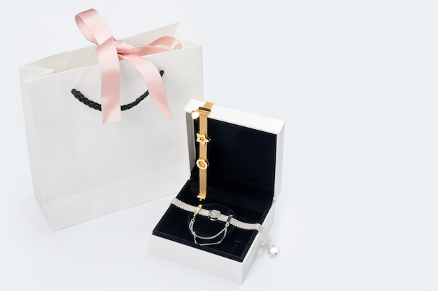 Silver and gold bracelets in gift box