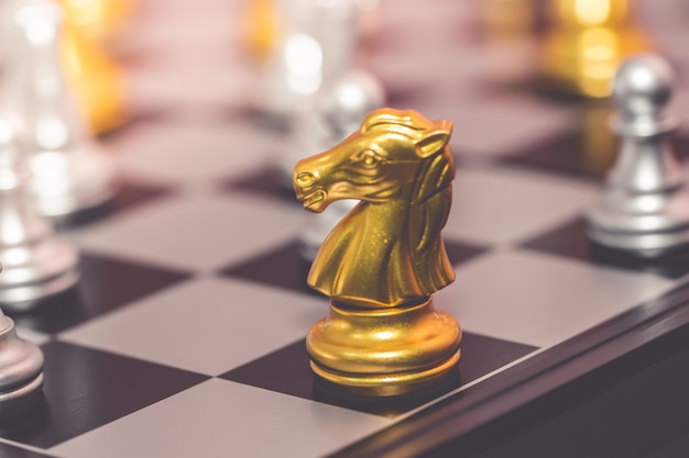 Silver and gold chess set for business concept