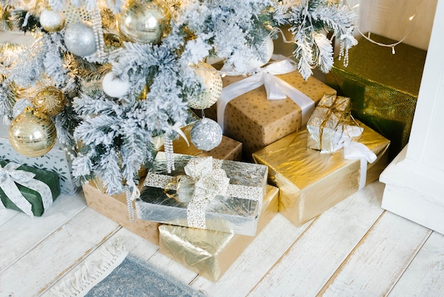 Silver and gold gifts for christmas and new year under the tree