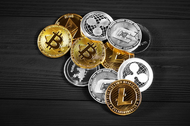 Silver and golden coins with bitcoin