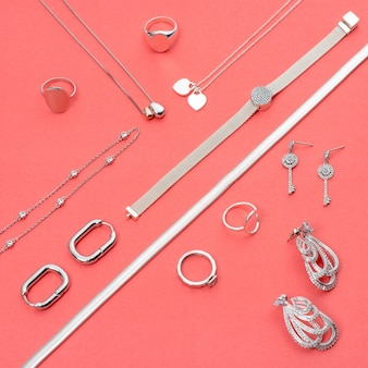 Silver jewelry on minimal pink background