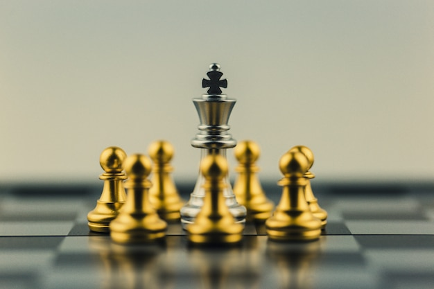 Silver king in chess business victory or decision the path to success.