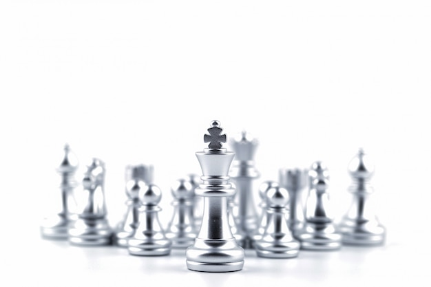 Silver king in chess game with concept for company strategy.