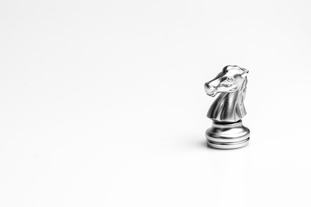 Silver knight chess piece isolated