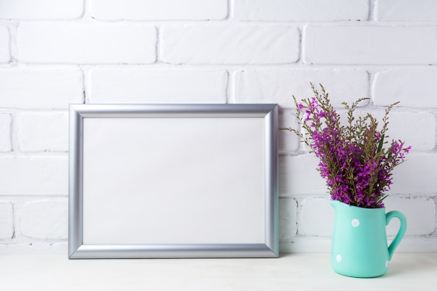 Silver landscape frame  with maroon purple flowers in mint pitcher