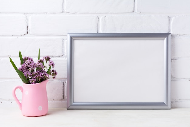 Silver landscape frame  with purple flowers in pink rustic pitcher