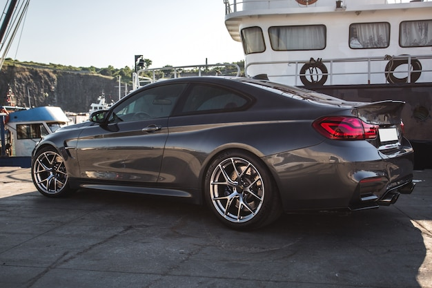 Silver luxury sport car in the port.