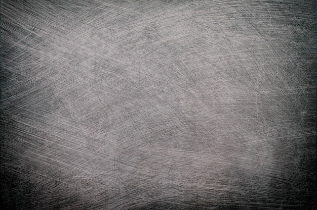 Silver metal brushed texture with vignette background.