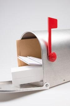 Silver metal mailbox open with mails and package