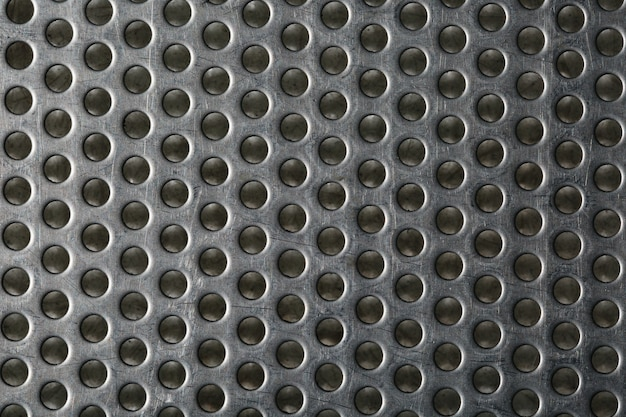 Silver metal shaped like a honeycomb for design .