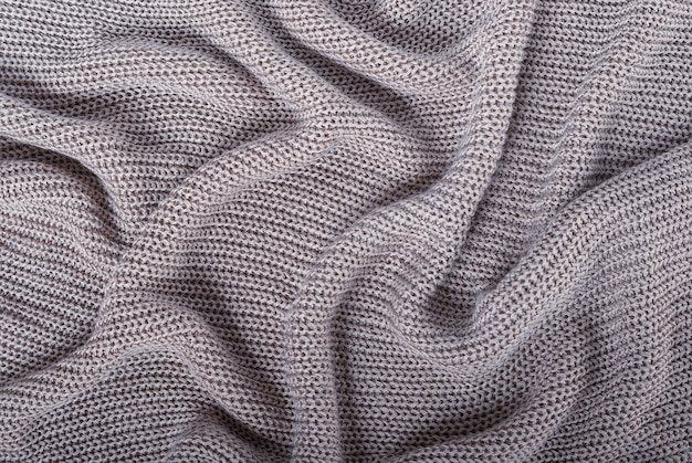Silver metal yarn knitted texture abstract background