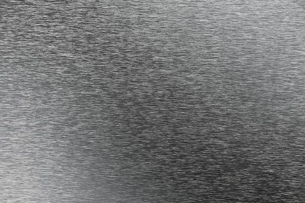 Серебристый металлический фон с темными пятнами