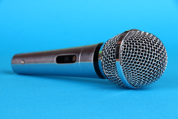 Silver microphone on blue