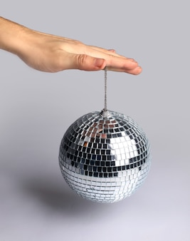 Silver mirror ball with hand