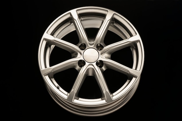 Silver new alloy wheel for car, front view.