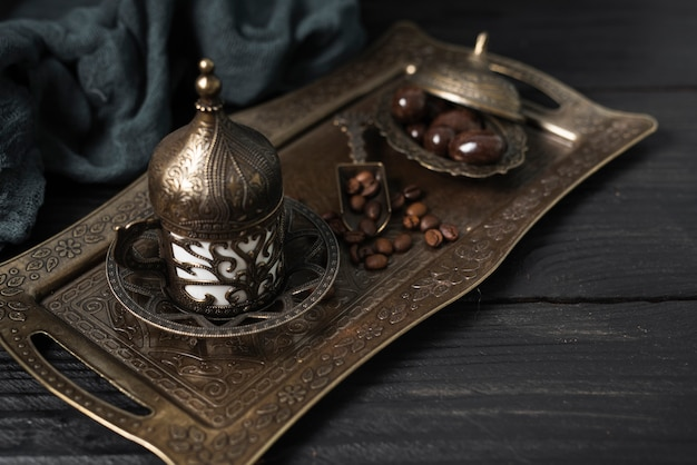 Silver plate with turkish cup of coffee