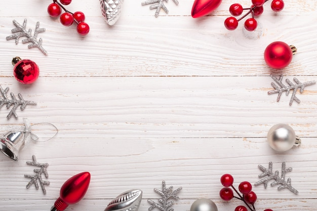 Silver red christmas decoration frame on white wooden background