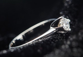 Silver ring on a black background. Macro picture