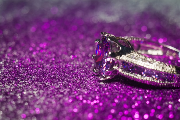 Silver ring with purple zircon