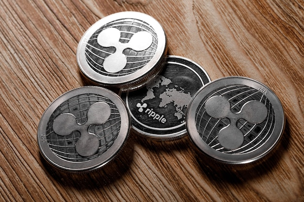 Silver ripple coins on wood background