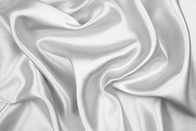 Silver silk texture luxurious satin for abstract background