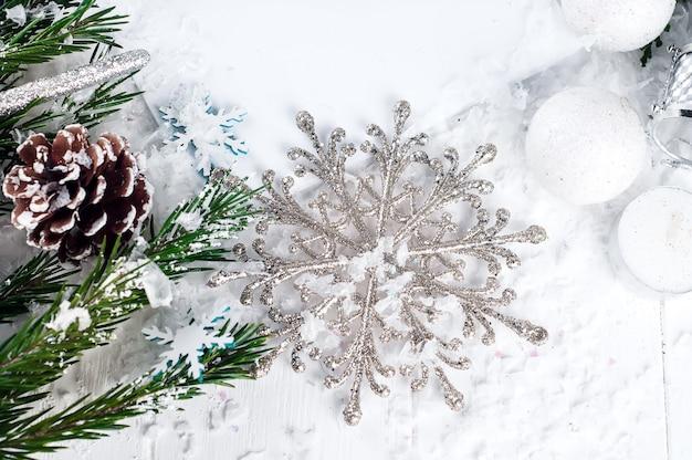 Silver snowflake on a white background