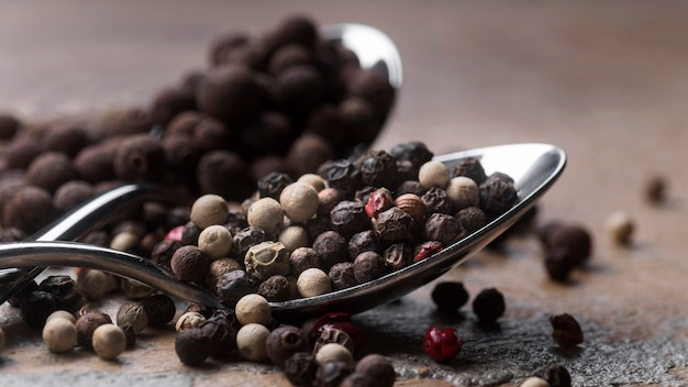 Silver spoon with peppercorns
