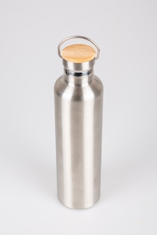 Silver stainless steel thermos wooden top on white