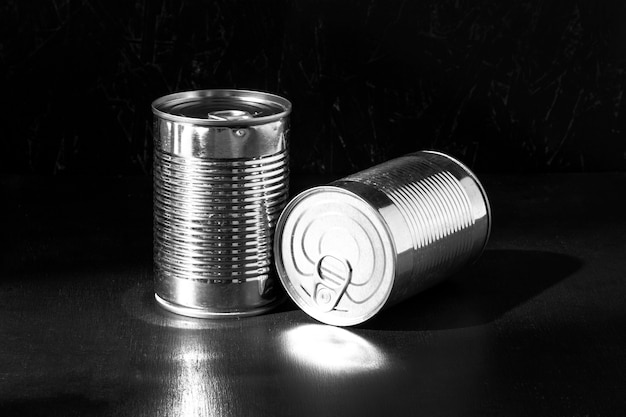 Silver tall round tin cans