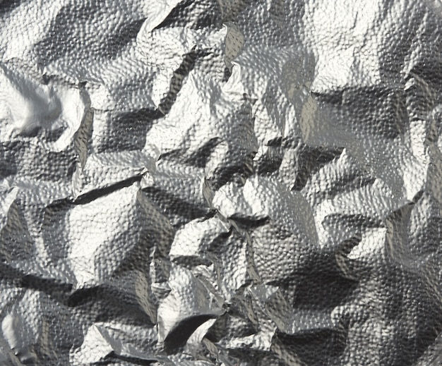 Silver texture of crumpled sheet of foil, full frame