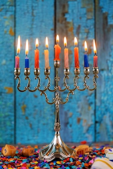 Silver traditional hanukkah candles all candle lite on the menorah