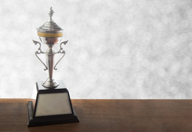 Silver trophy on wooden table