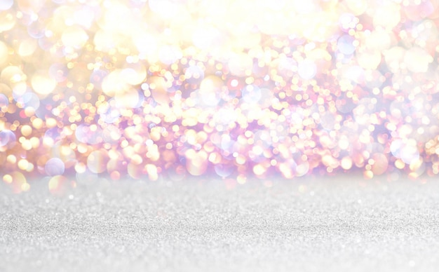 Silver and white glitter vintage lights background. defocused