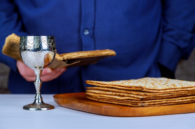 Silver wine cup with matzah, jewish symbols for the passover pesach holiday.