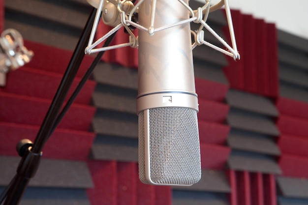 Silvered professional microphone in recording studio