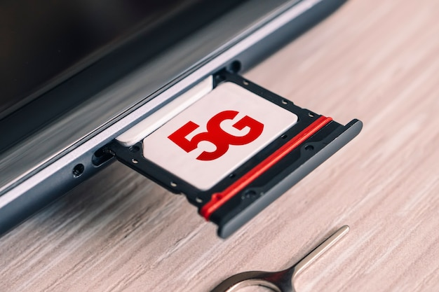 Sim card labeled 5g. replacing a sim card in mobile phone with high-speed internet.