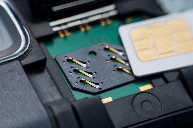 Sim card slot / socket in mobile smart phone close up.